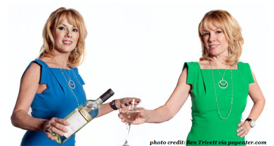 Ramona pours herself a glass of pinot while modeling both a blue and a green version of the dumb dress.  Note the horrific seams and ill fitting arm hole.