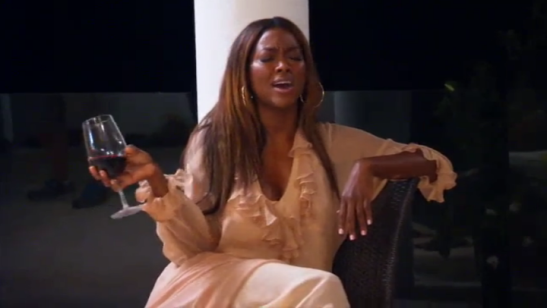 RHOA Kenya Moore drinking wine in Anguilla