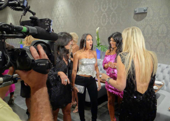 RHONJ Kim D yells at Melissa while Theresa laughs and Kathy looks on