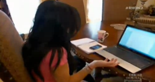 RHONJ Theresa Guidice stares at a laptop